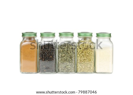 Spices in glass containers - stock photo