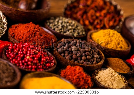 Spices in Indonesian wooden bowls - stock photo