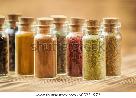 spices in jars on wooden background selective focus - Spice Jars