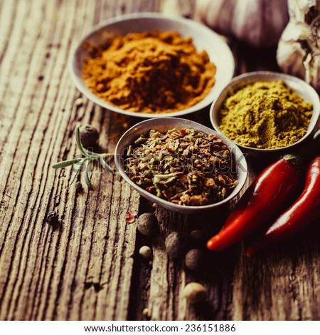 Spices in metal bowls  - stock photo