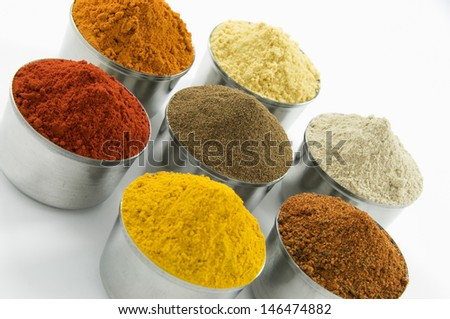 Spices in silver jars, isolated on white background - stock photo