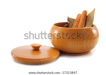 spices in wood container isolated on white