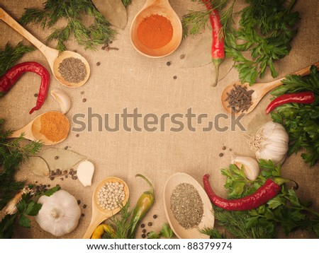 spices in wooden spoons against the background of the canvas - stock photo