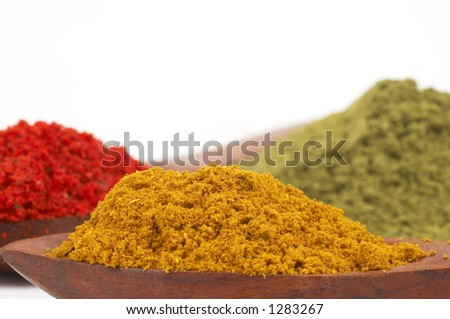 spices on white, shallow dof, space for messages - stock photo