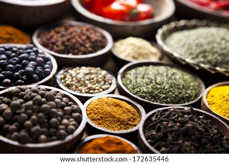 Spices on wooden bowl background   - stock photo