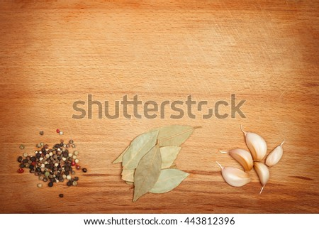 Spices on wooden framed background with empty space. Vibrant warm colors - stock photo