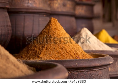 Spices pile (Curry Powder) in the  Marrakesh street shop, shallow dof - stock photo