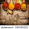 Spices. Spice over Wood. Herbs. Curry, Saffron, turmeric, cinnamon and other over wooden background - stock photo