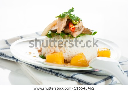 spicy asian food with rice pork and pineapple on white background