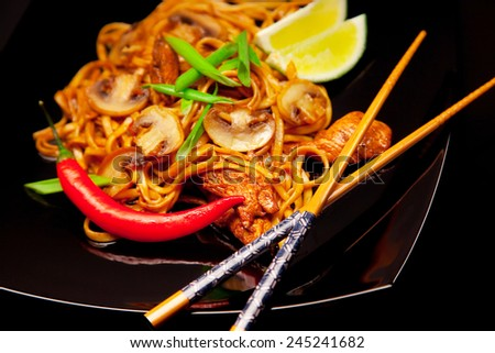 Spicy asian noodles with mushrooms, chicken and lime - stock photo