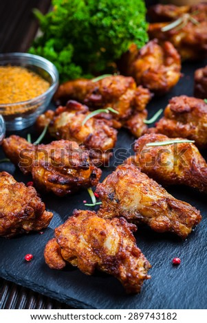 Spicy BBQ chicken wings with herbs and dips - stock photo