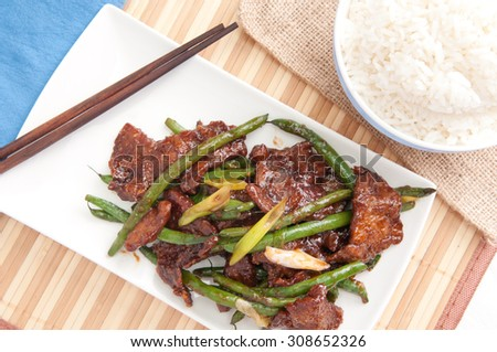 spicy beef and green beans with rice, thai inspired dinner - stock photo