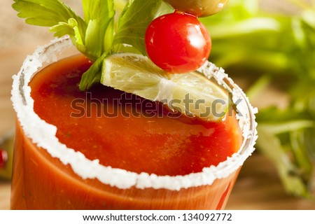 Spicy Bloody Mary Alcoholic Drink with a tomato garnish - stock photo
