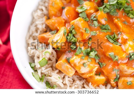 spicy butter chicken over brown rice with cilantro