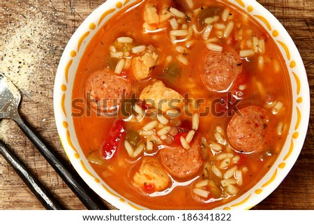 Spicy Cajun Chicken and Sausage Rice Gumbo on Table - stock photo