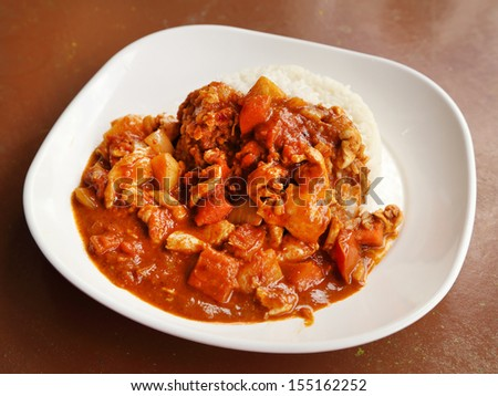 spicy chicken curry and rice on dish