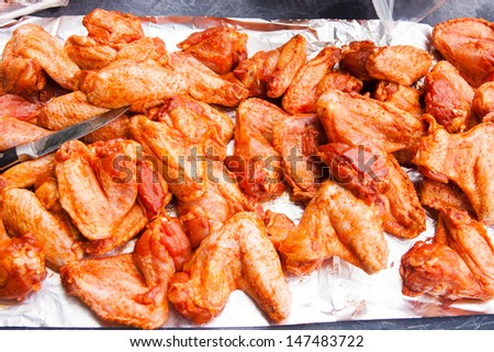 Spicy chicken wings, ready to grill - stock photo