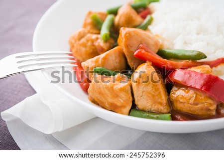 Spicy chicken with vegetables and rice close up. Oriental food. - stock photo