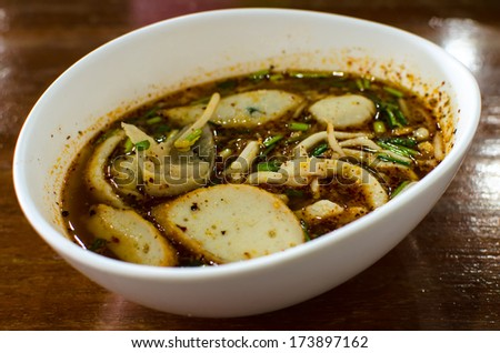 Spicy Fish Noodle With Wonton and Fish Balls  in Tomyum Soup  , Thai Food - stock photo