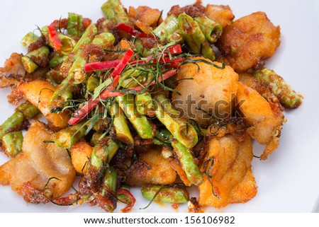 Spicy fried fish on white dish
