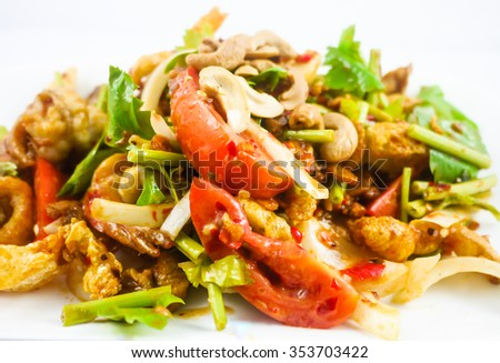Spicy fried pork skin and cashews salad , Thai Food isolated on white background - soft focus