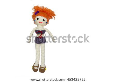 Spicy girl doll in short dressed on white background