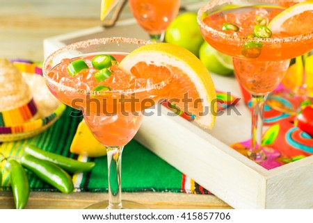 Spicy grapefruit margarita on ice in margarita glasses.