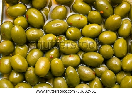 Spicy green olives - stock photo