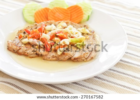 Spicy grill pork Thai style food. - stock photo