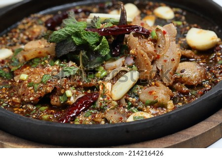 Spicy grilled pork's neck on hot plate