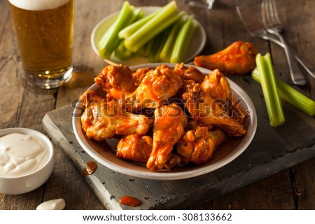 Spicy Homemade Buffalo Wings with Dip and Beer - stock photo