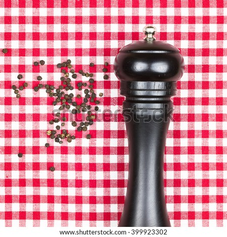 Spicy hot aromatic black peppercorns with pepper mill. - stock photo