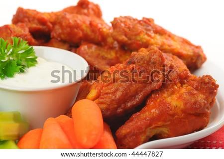 Spicy hot buffalo chicken wings shot closeup. - stock photo