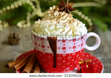 Spicy hot chocolate in a cup on christmas background.