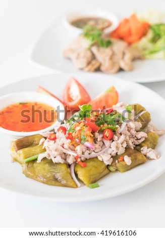 Spicy minced pork salad with flaming eggplant