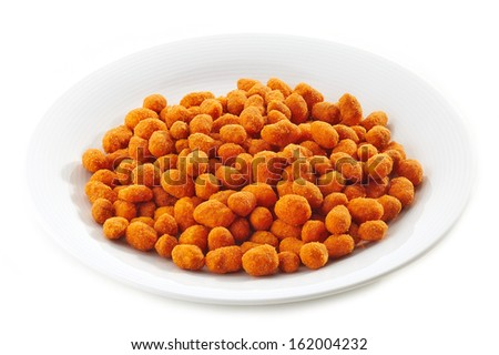 spicy nuts on white plate - stock photo
