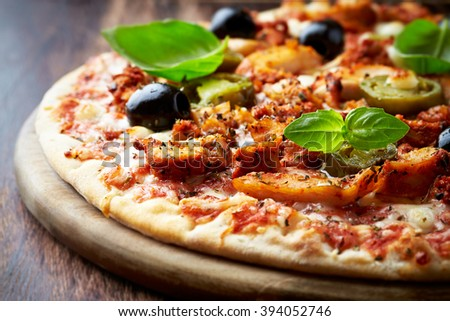 Spicy pizza with chicken and jalapeno pepper - stock photo