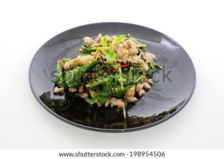 Spicy pork and basil fried - Thai dish (Pat-Ka-Praw-Moo) - stock photo