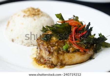 Spicy pork chop steak with rice. - stock photo