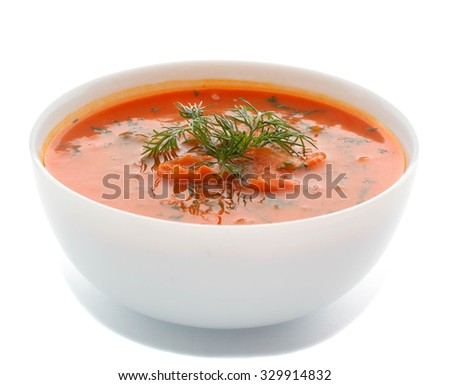 Spicy pumpkin soup on a white background. - stock photo