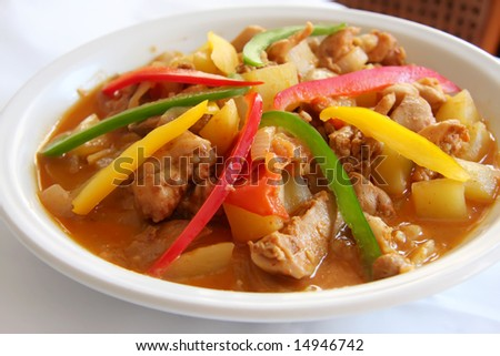 Spicy red meat curry traditional asian cuisine on white plate