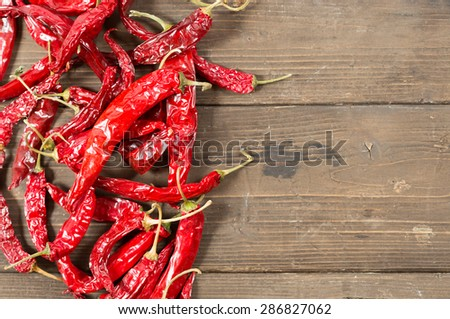 Spicy red pepper on a wooden table to make a sauce