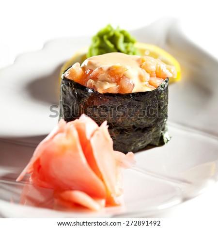 Spicy Salmon Gunkan Sushi. Garnished with Ginger and Wasabi - stock photo