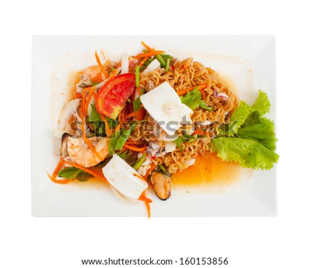 Spicy seafood noodles in white isolated ,tomato, vegetable,spicy ,yam thai - stock photo
