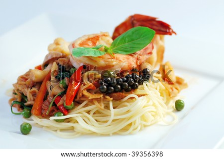 Spicy seafood spaghetti with many kind of herbs.
