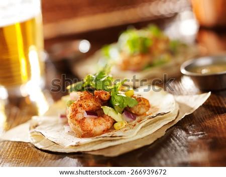 spicy shrimp avocado tacos in slanted composition - stock photo