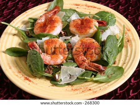 Spicy shrimp on a salad. - stock photo