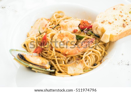 Spicy Spaghetti seafood in white plate