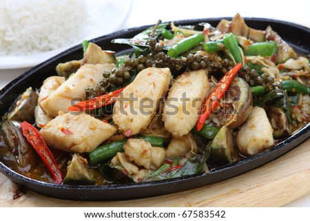 Spicy Stir Fried Fish Fillet with Herb - stock photo