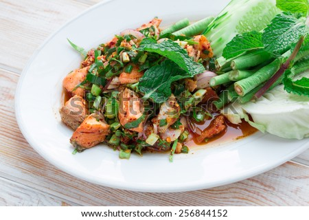spicy Thai food minced salmon with salad - stock photo